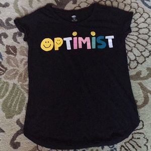 "A extra large T-Shirt that says ""Optimistic"" on it"